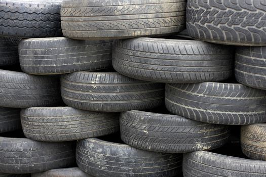 Heap of old tires arranged with neat
