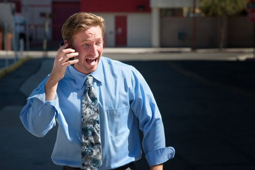 Good-looking guy excitedly talks on cell phone