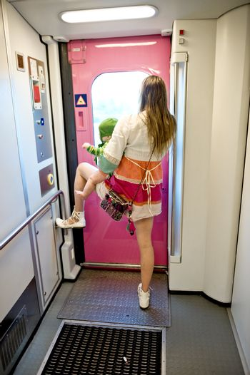 The woman with the child in the railway car, taken in Finland.