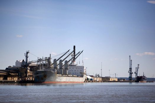 A large cargo ship in the harbour