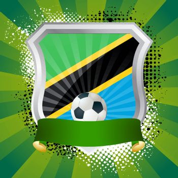 EPS 10. Shiny metal shield on bright background with flag of Tanzania