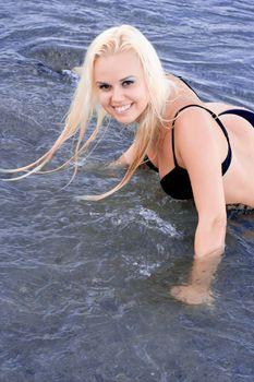 blond woman lying in water