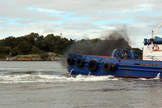 fumes from a river shannon tug boat
