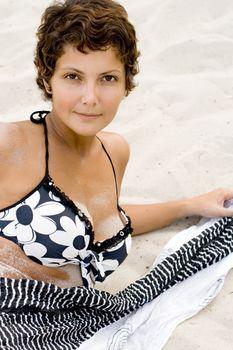 woman lying on a sand