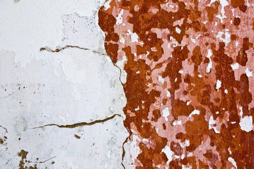View of an old and peeled painted wall texture.