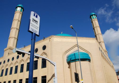 A photograph of a Mosque in Sheffield, a northern English city, next to a bus stop.
