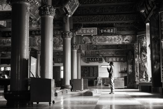 Chinese temple interior with prayer