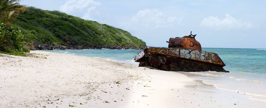 An old rusted and deserted army tank of Flamenco beach on the Puerto Rican island of Culebra. Paradise lost.
