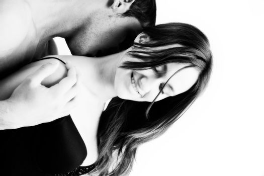 Young adult couple in the studio kissing