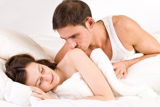 Young adult couple in the studio sleeping