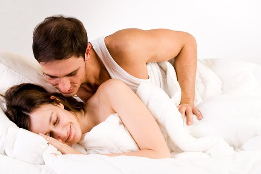 Young adult couple in the studio waking up