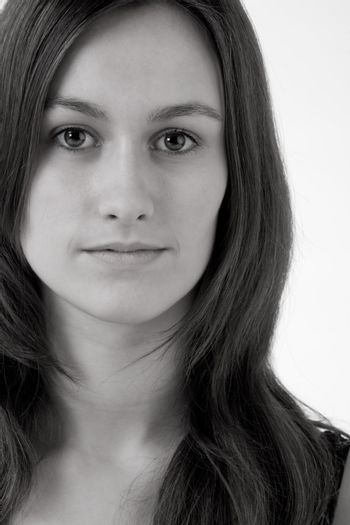 Young woman portrait in the studio on a white background