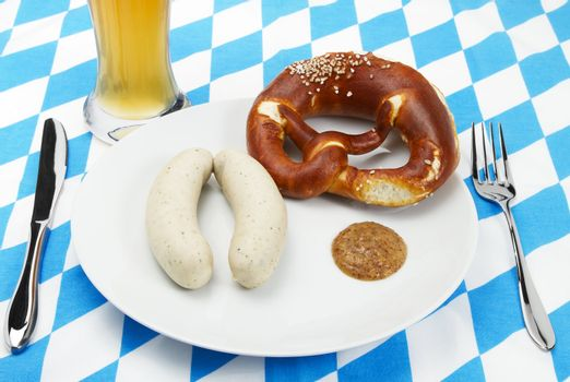 bavarian veal sausage setup with beer from top
