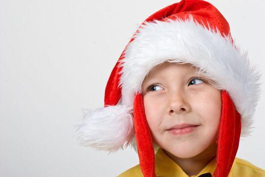 portrait of little boy in the santa`s cap