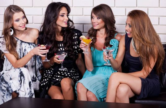 Group of woman at cocktail party have fun