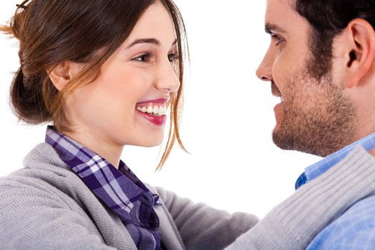 Close up view of loving couple looking at each other against white background