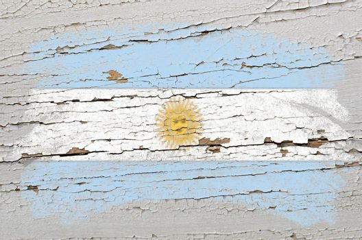Chalky argentinian flag painted with color chalk on grunge wooden texture