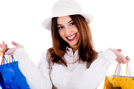 Close up of lady holding shopping bags on white background