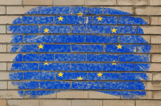Chalky european union flag painted with color chalk on grunge old brick wall