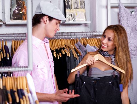Portrait of lovable couple shopping in fashion cloth retail store