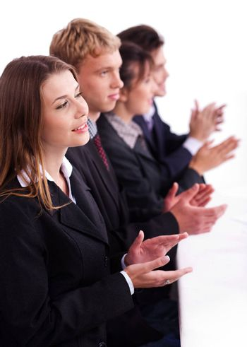 Colleagues applauding during a business meeting over white background