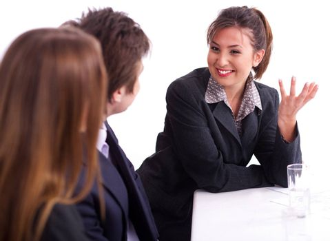 Smiling businesswoman having healthy discussion with fellow mates