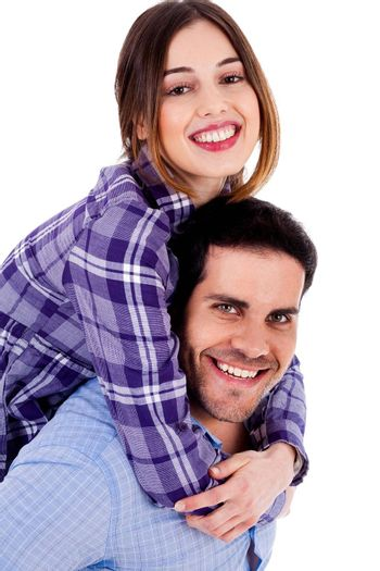 Portrait of young man giving piggyride to her girlfriend against isolated white background
