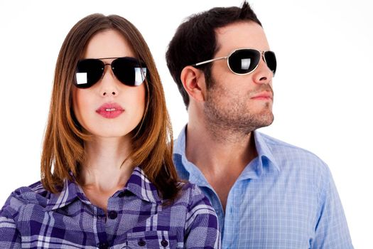 closeup of young man and woman wearing sunglasses