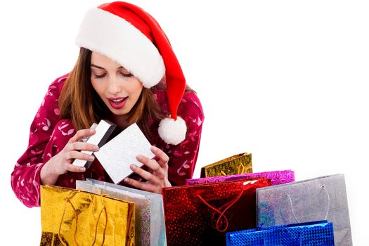 young lady getting surprise on opening christmas gift box