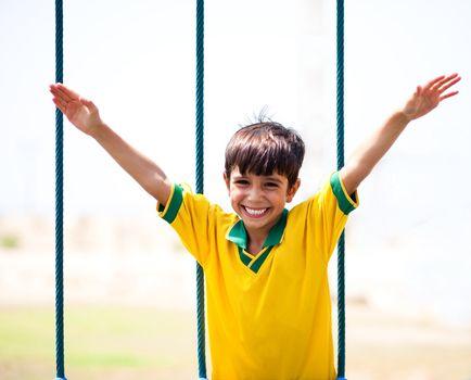 Little boy having fun as he runs with arms wide open