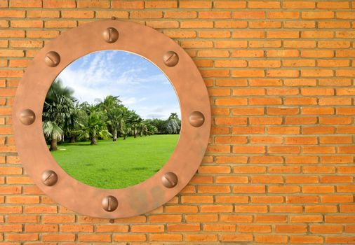 Blue sky in hole in old wall, brick frame
