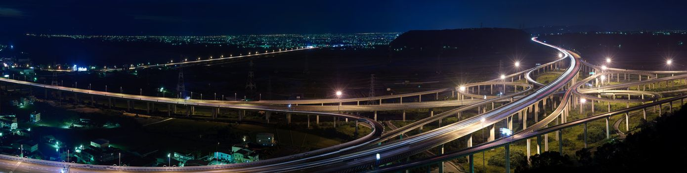 Panoramic cityscape of freeway in night