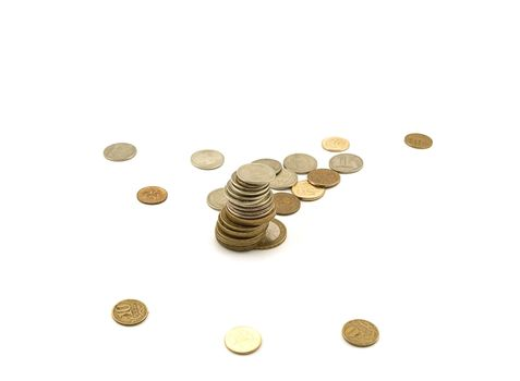 Scattering of coins on white background