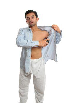 Man using underarm deodorant perspirant spray