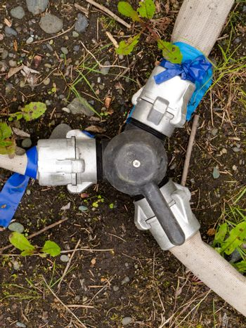 Diverter valve with three fire hoses attached