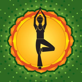 Woman standing in yoga pose against green background