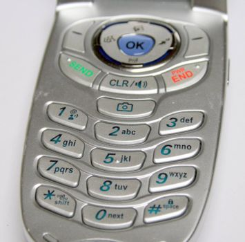 keypad of a new cell phone, in a silver case