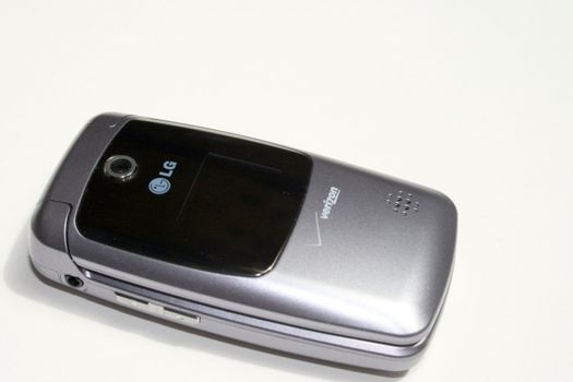 a new LG brand cell phone, in a silver case