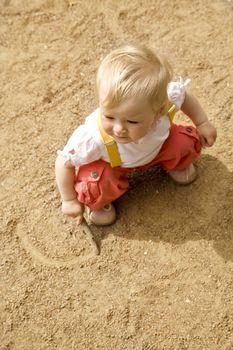 little girl on a sand
