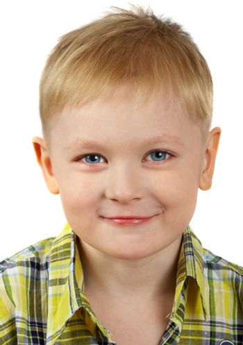 The portrait of the boy of the blonde which smiles.