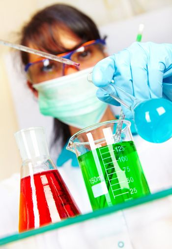 scientist in laboratory with test tubes