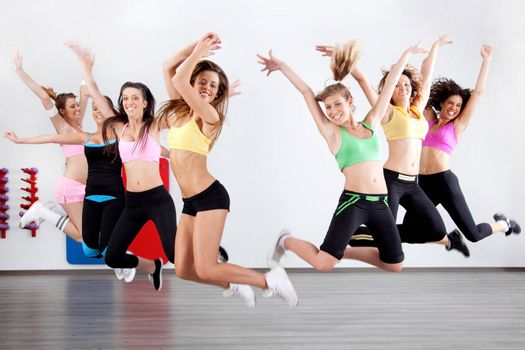 group of ladies working out in aerobic class