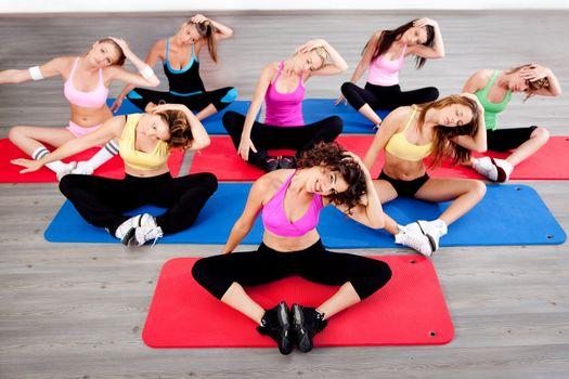 image of women doing floor excercise in aerobics class