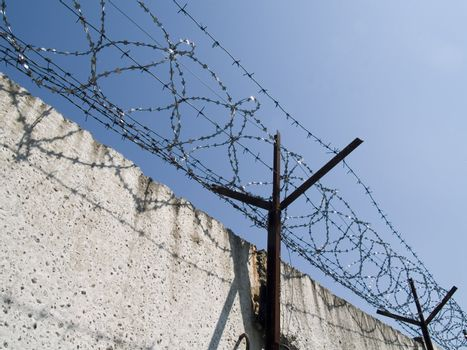 Barbed wire on a background blue sky