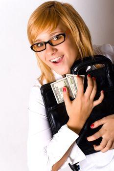 businesswoman with portfolio and money