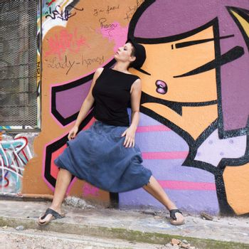 woman dancing in front of a wall