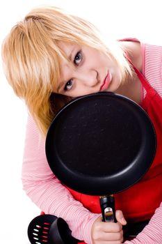 sad housewife with pan
