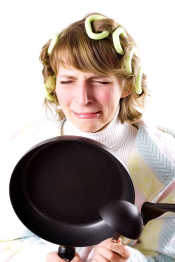 crying housewife with pan