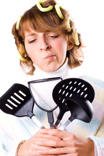 housewife with kitchen utensil