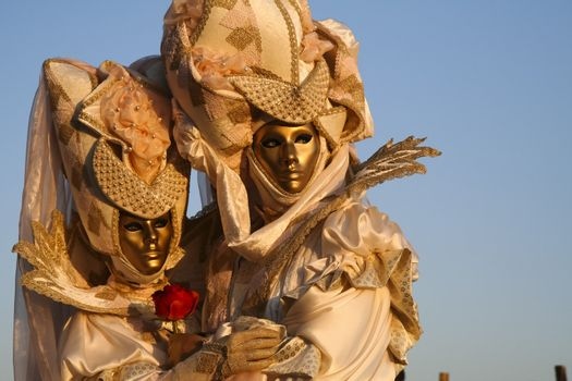 A masked couple in love at the Venice Carnival